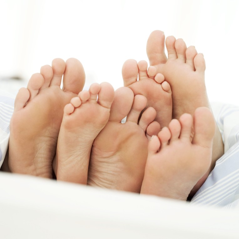 Soles of a Couple and Their Child --- Image by © Royalty-Free/Corbis